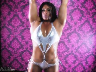 Ripped Tina Rock flexes her big muscles-9